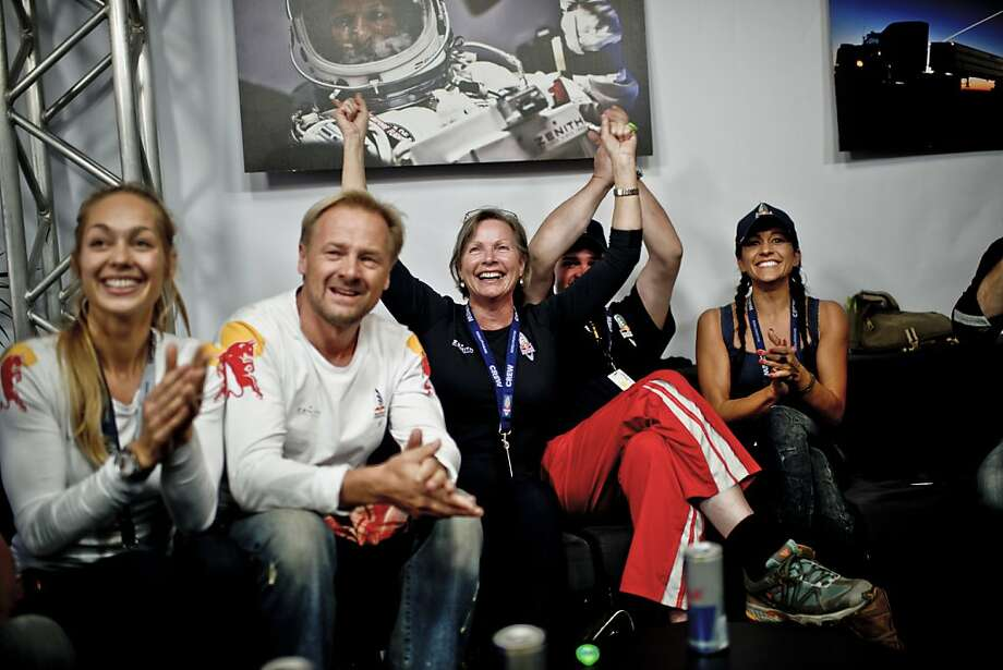 This picture provided by www.redbullcontentpool.com shows family members and friends celebrating the successful jump of pilot Felix Baumgartner of Austria aboard Red Bull Stratos in Roswell, New Mexico on October 14, 2012. Austrian daredevil Felix Baumgartner became the first man to break the sound barrier in a record-shattering freefall jump from the edge of space, organizers said. The 43-year-old leapt from a capsule more than 24 miles (39 kilometers) above the Earth, reaching a speed of 706 miles per hour (1,135 km/h) before opening his red and white parachute and floating down to the New Mexico desert. Photo: Joerg Mitter, AFP/Getty Images