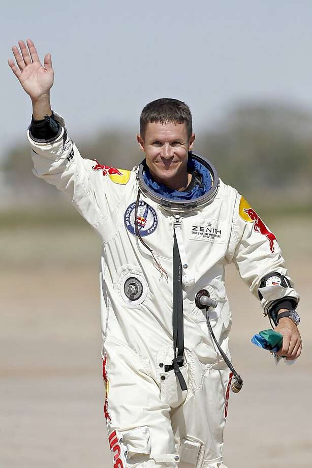 Felix Baumgartner, of Austria, waves to the crowd after successfully jumping from a space capsule lifted by a helium balloon at a height of just over 128,000 feet above the Earth's surface, Sunday, Oct. 14, 2012, in Roswell, N.M. Photo: Ross Franklin, Associated Press