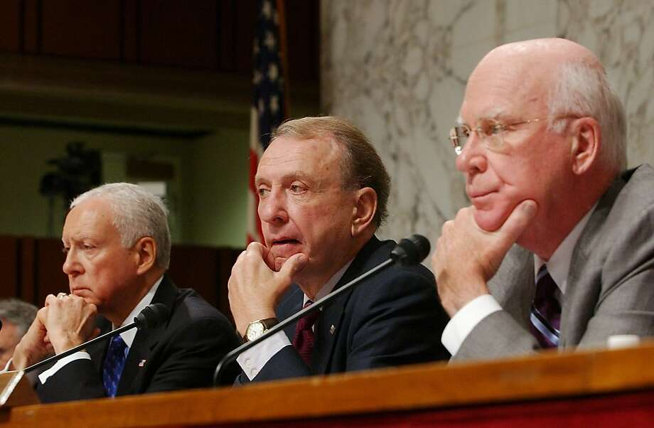 Sen. Arlen Specter, R-Pa. (center), chairs a 2006 Judiciary Committee hearing attended by Sens. Orrin Hatch, R-Utah (left), and Patrick Leahy, D-Vt. Photo: Dennis Cook, AP