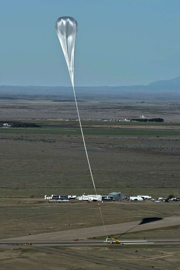 In this handout provided by Red Bull Stratos, a crane launches the capsule and balloon during the final manned flight for Red Bull Stratos October 14, 2012 in Roswell, New Mexico. Austrian Felix Baumgartner broke the world record for the highest, and fastest free fall in history by making a 23-mile ascent in capsule attached to a massive balloon. Photo: Handout, Getty Images / 2012 Red Bull Stratos