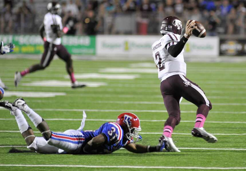 Louisiana Tech's Chad Boyd reaches out to tackle Texas A&M quarterback Johnny Manziel in the fourth