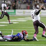 Louisiana Tech's Chad Boyd reaches out to tackle Texas A&M quarterback Johnny Manziel in the fourth quarter during an NCAA football game in Shreveport, La.,Saturday, Oct. 13, 2012. (AP Photo/Kita K Wright)