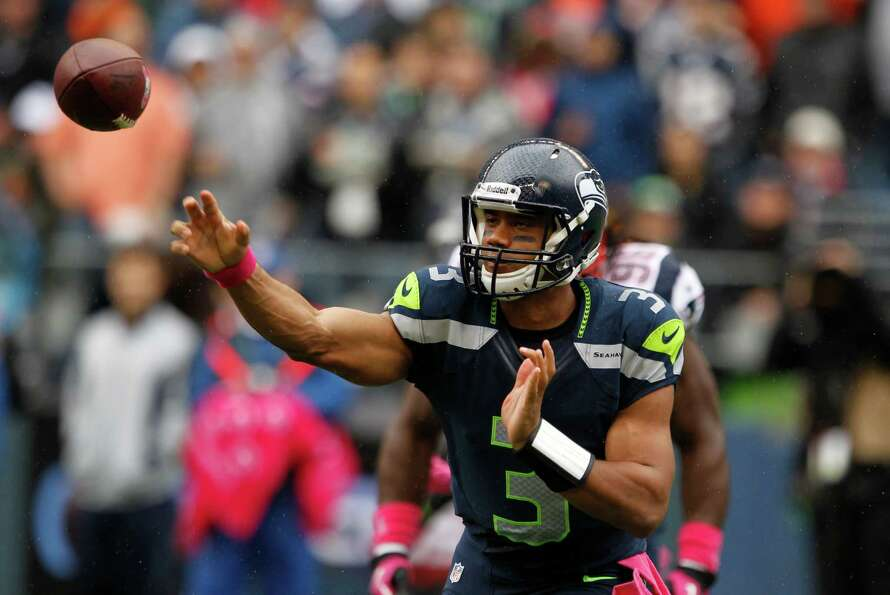 Seattle Seahawks quarterback Russell Wilson passes in the first half of an NFL football game against
