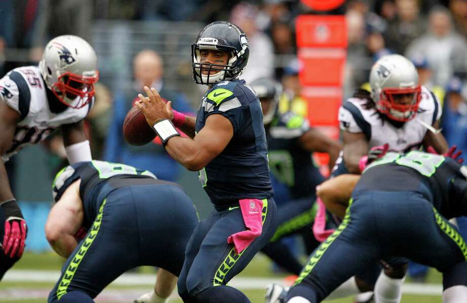 Seattle Seahawks quarterback Russell Wilson looks to pass in the first half of an NFL football game against the New England Patriots, Sunday, Oct. 14, 2012, in Seattle. Photo: AP