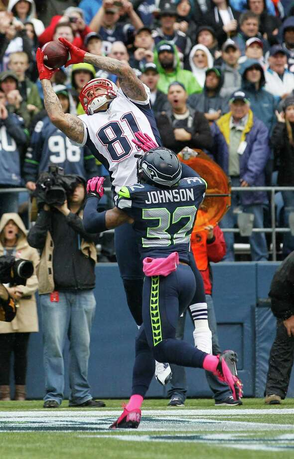 New England Patriots' Aaron Hernandez makes a catch for a touchdown above the defense of Seattle Seahawks' Jeron Johnson (32) in the first half of an NFL football game, Sunday, Oct. 14, 2012, in Seattle. Photo: AP