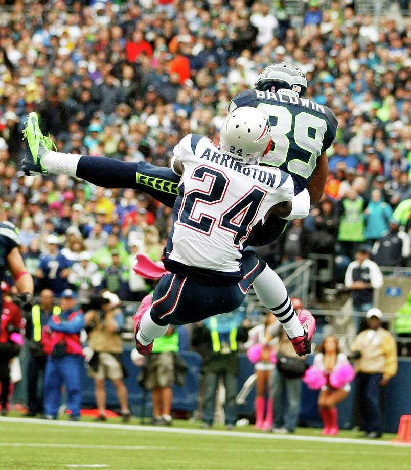 Seattle Seahawks' Doug Baldwin (89 )makes a catch for a touchdown as New England Patriots cornerback Kyle Arrington (24) tries to defend in the first half of an NFL football game, Sunday, Oct. 14, 2012, in Seattle. Photo: AP