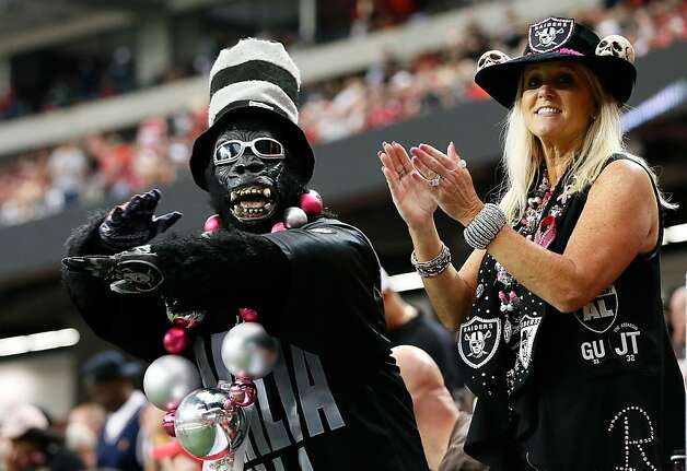 ATLANTA, GA - OCTOBER 14:  Two Oakland Raiders fans watch the game against the Atlanta Falcons at Georgia Dome on October 14, 2012 in Atlanta, Georgia.  (Photo by Kevin C. Cox/Getty Images) Photo: Kevin C. Cox, Getty Images
