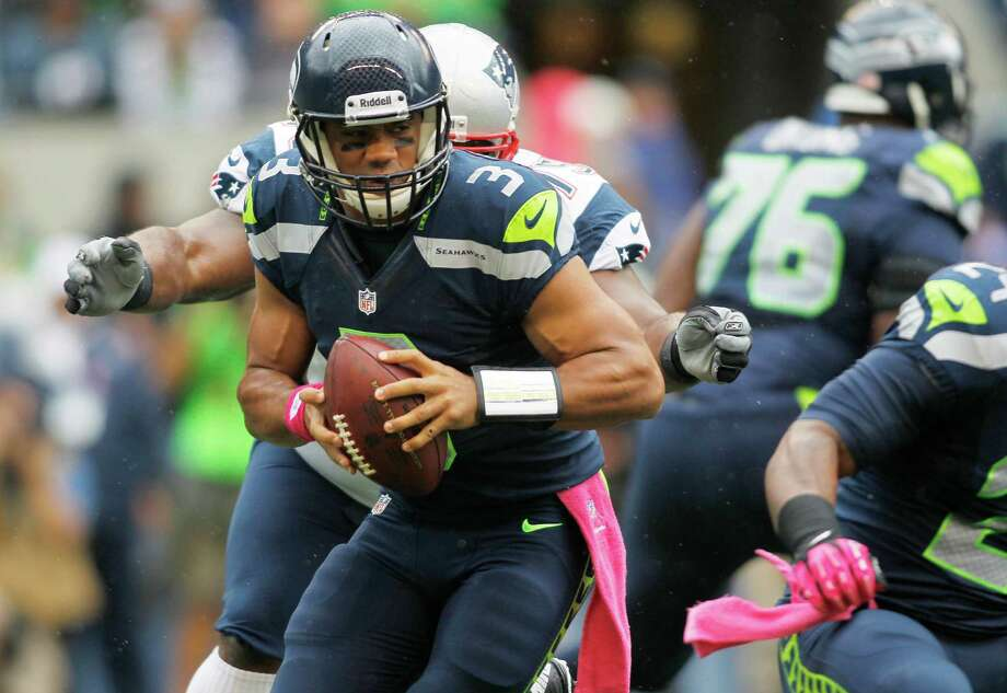 Seattle Seahawks quarterback Russell Wilson (3) is sacked by New England Patriots defensive tackle Vince Wilfork