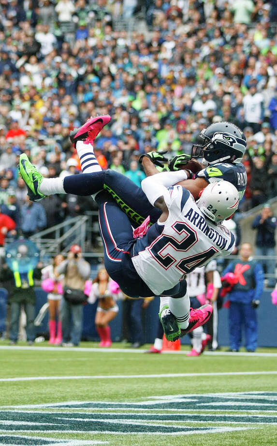 Seattle Seahawks' Doug Baldwin (89)makes a catch for a touchdown as New England Patriots cornerback Kyle Arrington (24) tries to defend in the first half of an NFL football game, Sunday, Oct. 14, 2012, in Seattle. Photo: AP