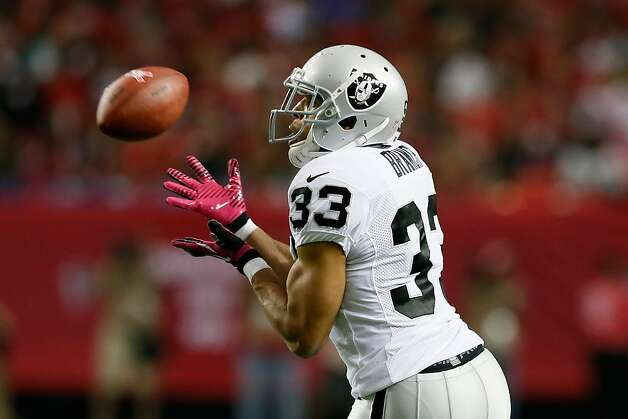 ATLANTA, GA - OCTOBER 14:  Tyvon Branch #33 of the Oakland Raiders intercepts a pass by Matt Ryan #2 of the Atlanta Falcons at Georgia Dome on October 14, 2012 in Atlanta, Georgia.  (Photo by Kevin C. Cox/Getty Images) Photo: Kevin C. Cox, Getty Images