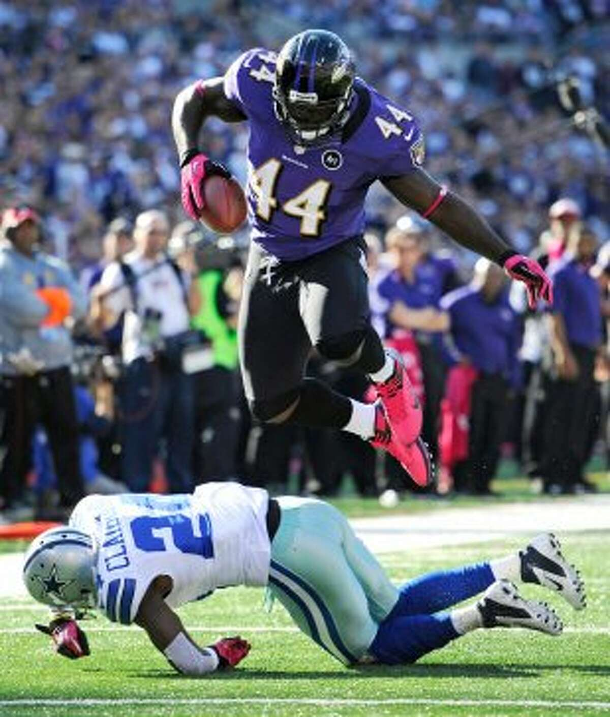 Baltimore Ravens fullback Vonta Leach, top, leaps over Dallas Cowboys cornerback Morris Claiborne in the second half of an NFL football game in Baltimore, Sunday, Oct. 14, 2012. Baltimore won 31-29. (AP Photo/Nick Wass) (Associated Press)