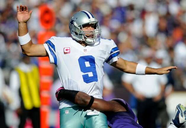 Dallas Cowboys quarterback Tony Romo reacts as he is tackled by Baltimore Ravens outside linebacker Courtney Upshaw in the second half of an NFL football game in Baltimore, Sunday, Oct. 14, 2012. (AP Photo/Nick Wass) (Associated Press)