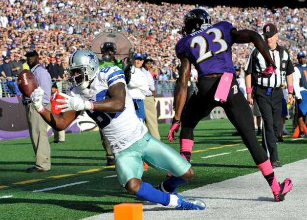 Dallas Cowboys wide receiver Dez Bryant, left, misses a pass attempt in the end zone as he is pressured by Baltimore Ravens defensive back Chykie Brown in the second half of an NFL football game in Baltimore, Sunday, Oct. 14, 2012. Baltimore won 31-29. (AP Photo/Gail Burton) (Associated Press)
