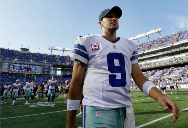 Dallas Cowboys quarterback Tony Romo walks off the field after an NFL football game against the Baltimore Ravens in Baltimore, Sunday, Oct. 14, 2012. Baltimore won 31-29. (AP Photo/Patrick Semansky) (Associated Press)