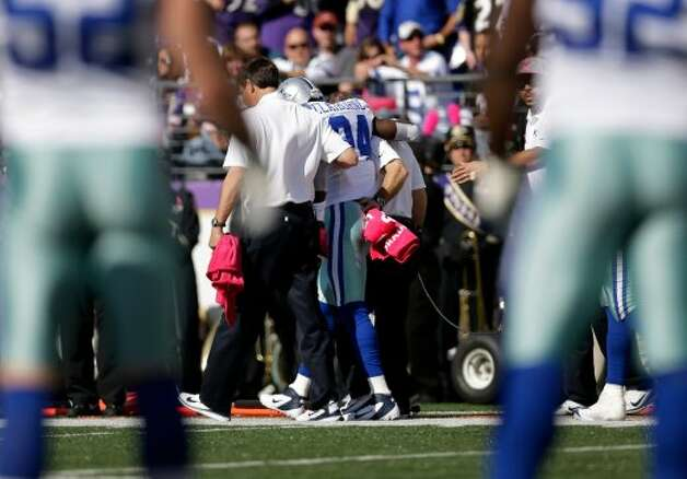 Dallas Cowboys cornerback Morris Claiborne, center, is assisted off the field after injuring himself on a play in the first half of an NFL football game against the Baltimore Ravens in Baltimore, Sunday, Oct. 14, 2012. (AP Photo/Patrick Semansky) (Associated Press)