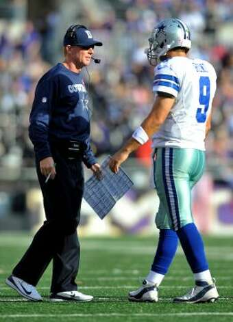 Dallas Cowboys head coach Jason Garrett, left, speaks with quarterback Tony Romo in the second half of an NFL football game against the Baltimore Ravens in Baltimore, Sunday, Oct. 14, 2012. (AP Photo/Gail Burton) (Associated Press)