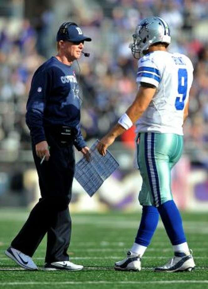 Cowboys coach Jason Garrett, left, speaks with quarterback Tony Romo in the second half against the Ravens in Baltimore, Sunday, Oct. 14, 2012. (AP Photo/Gail Burton)