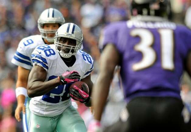 Dallas Cowboys running back Felix Jones (28) rushes for a touchdown in the first half of an NFL football game against the Baltimore Ravens in Baltimore, Sunday, Oct. 14, 2012. (AP Photo/Gail Burton) (Associated Press)