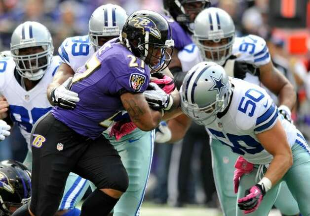 Baltimore Ravens running back Ray Rice (27) rushes the ball in the first half of an NFL football game against the Dallas Cowboys in Baltimore, Sunday, Oct. 14, 2012. (AP Photo/Gail Burton) (Associated Press)