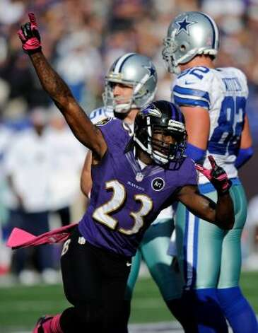 Baltimore Ravens defensive back Chykie Brown reacts in front of Dallas Cowboys kicker Dan Bailey, back left, and tight end Jason Witten after Bailey missed a field goal attempt in the second half of an NFL football game in Baltimore, Sunday, Oct. 14, 2012. Baltimore won 31-29. (AP Photo/Nick Wass) (Associated Press)