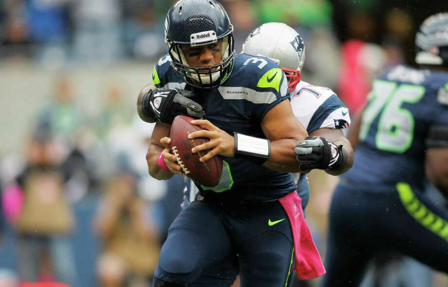 Seattle Seahawks quarterback Russell Wilson (3) is sacked by New England Patriots defensive tackle Vince Wilfork throws in the first half of an NFL football game, Sunday, Oct. 14, 2012, in Seattle. Photo: AP