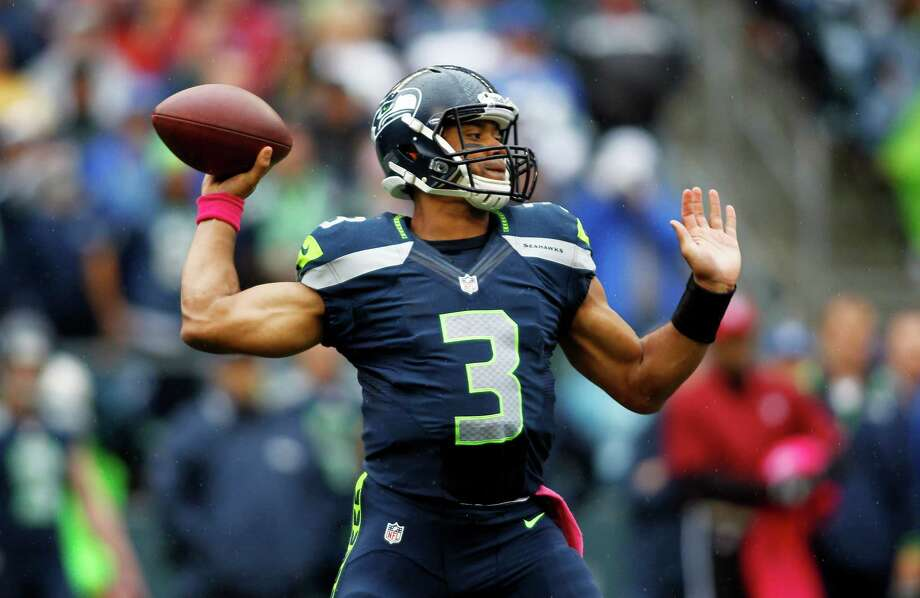 Seattle Seahawks quarterback Russell Wilson throws in the first half of an NFL football game against the New England Patriots, Sunday, Oct. 14, 2012, in Seattle. Photo: AP