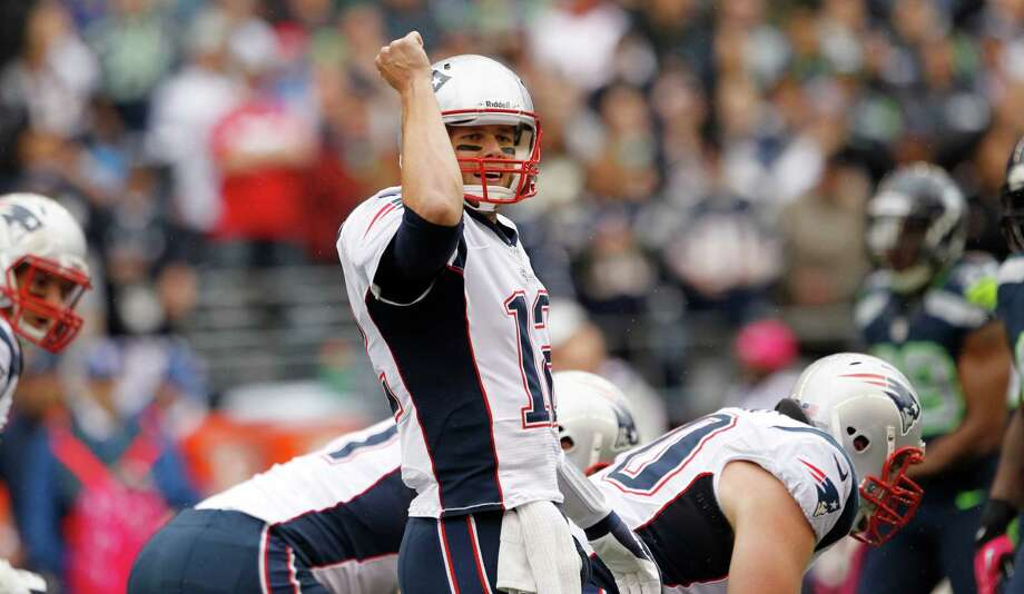 New England Patriots quarterback Tom Brady calls to his team in the first half of an NFL football game against the Seattle Seahawks, Sunday, Oct. 14, 2012, in Seattle. Photo: AP