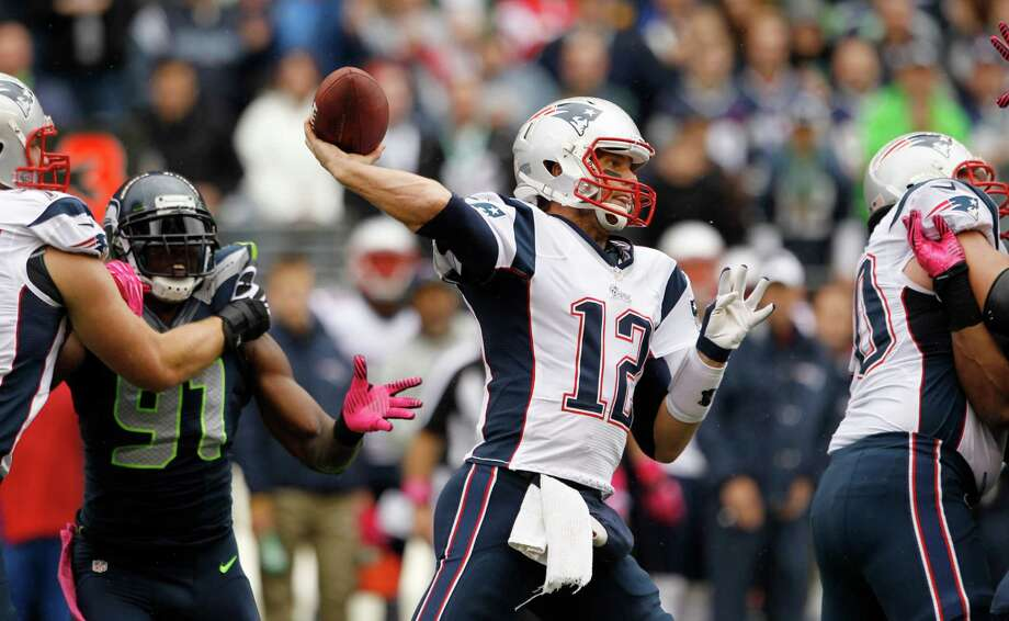 New England Patriots quarterback Tom Brady throws in the first half against the Seattle Seahawks in an NFL football game, Sunday, Oct. 14, 2012, in Seattle. Photo: AP