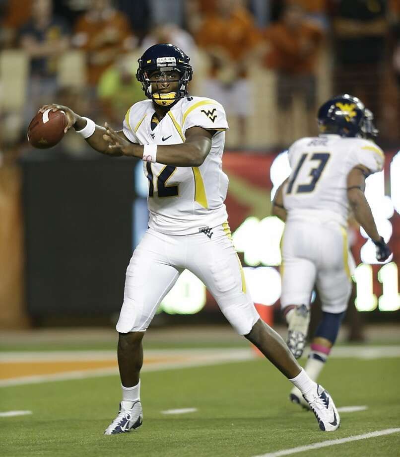 West Virginia's Geno Smith has hit on 75.3 percent of his passes, with 25 touchdowns. Photo: Eric Gay, Associated Press