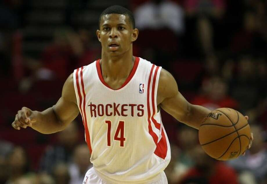 Rockets point guard Scott Machado brings the ball up during the second quarter. (James Nielsen / © Houston Chronicle 2012)