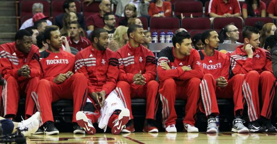 Rockets players rest on the bench and hope to see playing time during the first quarter. (James Nielsen / © Houston Chronicle 2012)