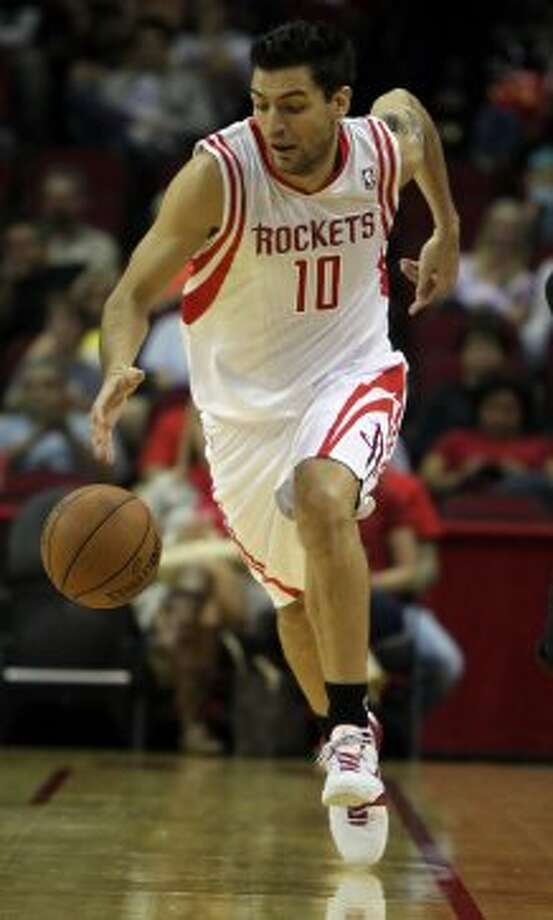 Rockets forward Carlos Delfino pushes the tempo during the first quarter. (James Nielsen / © Houston Chronicle 2012)