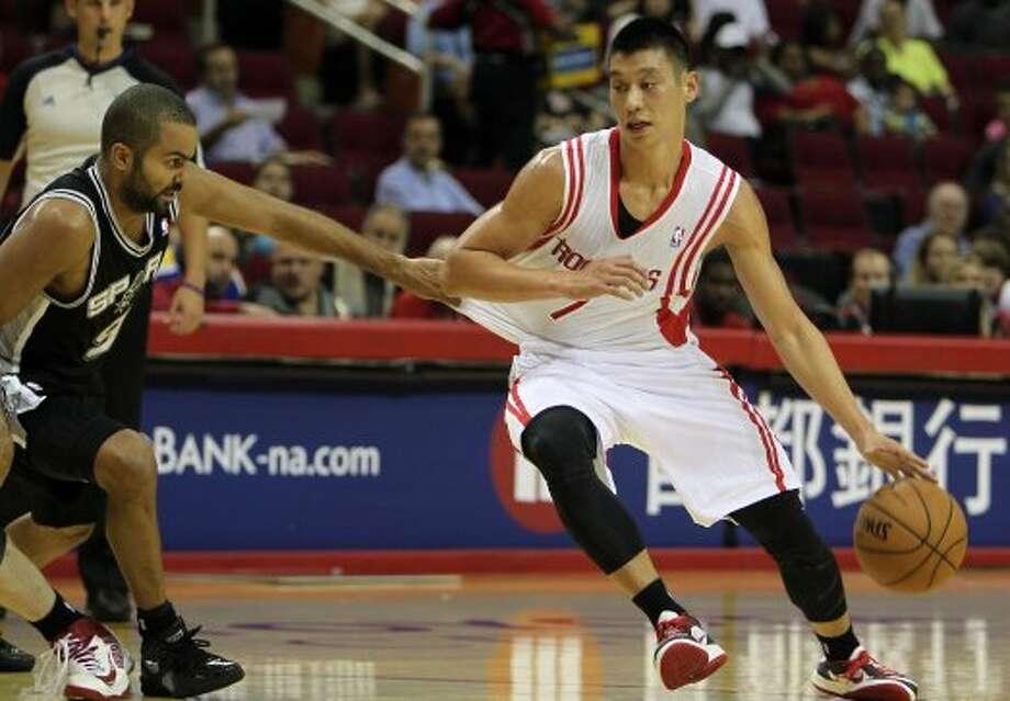 Rockets guard Jeremy Lin tries to get past Spurs guard Tony Parker. (James Nielsen / © Houston Chronicle 2012)
