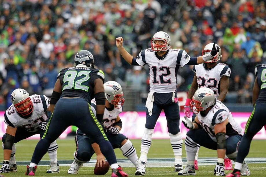 New England Patriots quarterback Tom Brady (12) calls to his team in action against the Seattle Seahawks in the first half of an NFL football game, Sunday, Oct. 14, 2012, in Seattle. Photo: AP