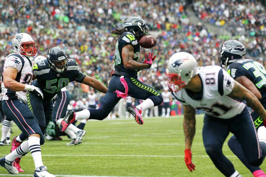 Seattle Seahawks' Earl Thomas breaks up a pass in the first half of an NFL football game against the