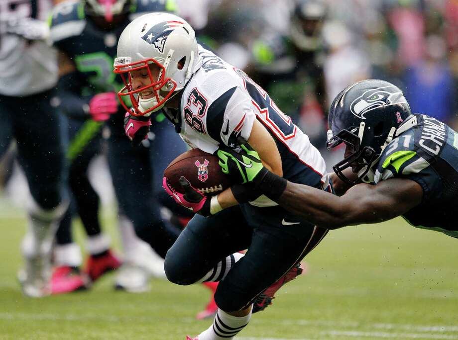 New England Patriots' Wes Welker (83) carries the ball as Seattle Seahawks' Kam Chancellor tackles him in the first half of an NFL football game, Sunday, Oct. 14, 2012, in Seattle. Photo: AP