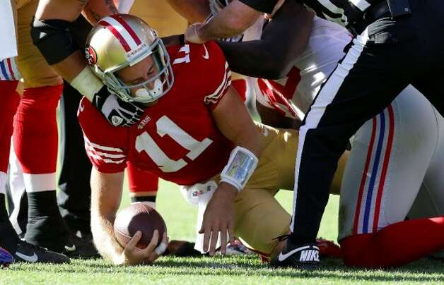 San Francisco 49ers quarterback Alex Smith (11) is sacked by New York Giants defensive tackle Linval Joseph during the third quarter of an NFL football game in San Francisco, Sunday, Oct. 14, 2012.