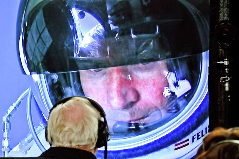 In this photo provided by Red Bull, pilot Felix Baumgartner of Austria is seen in a screen at mission control center in the capsule during the final manned flight for Red Bull Stratos in Roswell, N.M. on Sunday, Oct. 14, 2012.   Baumgartner plans to jump from an altitude of 120,000 feet, an altitude chosen to enable him to achieve Mach 1 in free fall, which would deliver scientific data to the aerospace community about human survival from high altitudes.(AP Photo/Red Bull Stratos, Stefan Aufschnaiter) MANDATORY CREDIT Photo: Stefan Aufschnaiter