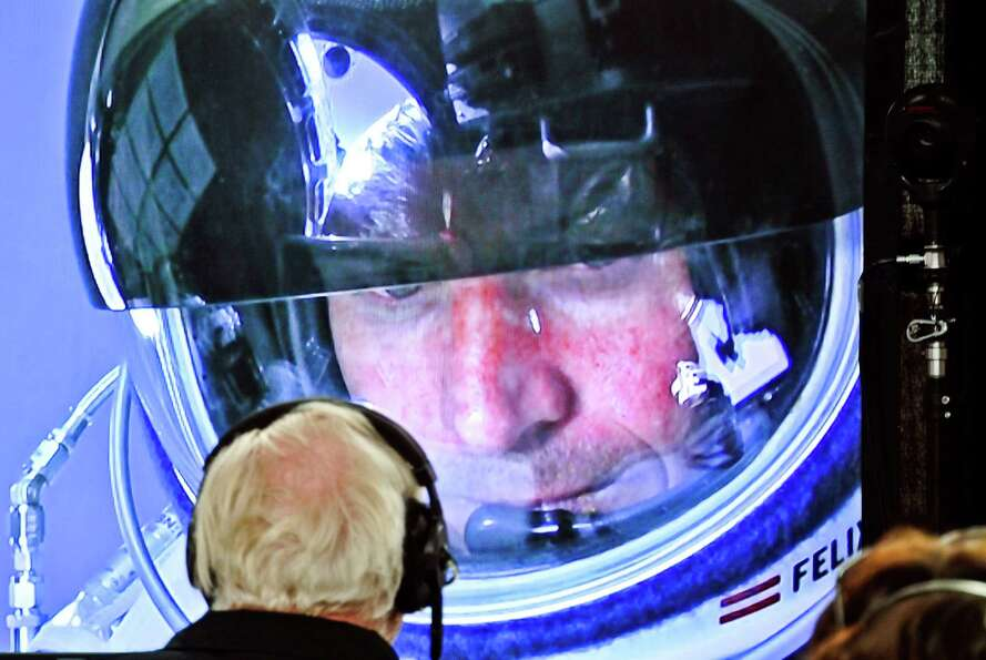 In this photo provided by Red Bull, pilot Felix Baumgartner of Austria is seen in a screen at missio
