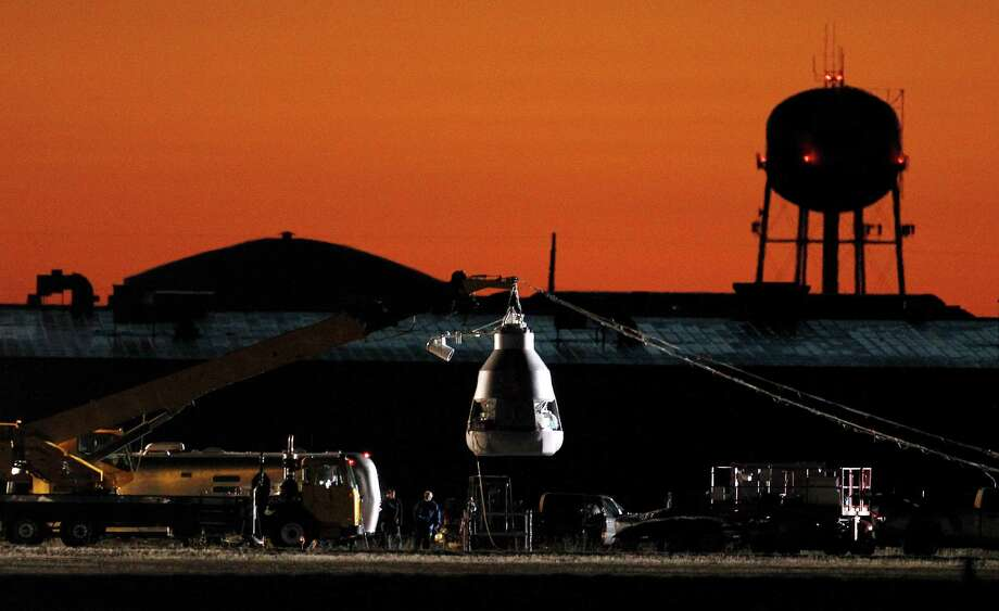 As the sun rises, workers prepare at the launch site, ahead of an attempt by Felix Baumgartner to break the speed of sound with his own body by jumping from a space capsule lifted by a helium balloon, Sunday, Oct. 14, 2012, in Roswell, N.M.  Baumgartner plans to jump from an altitude of 120,000 feet, an altitude chosen to enable him to achieve Mach 1 in free fall, which would deliver scientific data to the aerospace community about human survival from high altitudes.(AP Photo/Ross D. Franklin) Photo: Ross Franklin