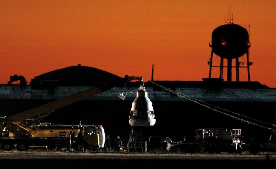 As the sun rises, workers prepare at the launch site, ahead of an attempt by Felix Baumgartner to br