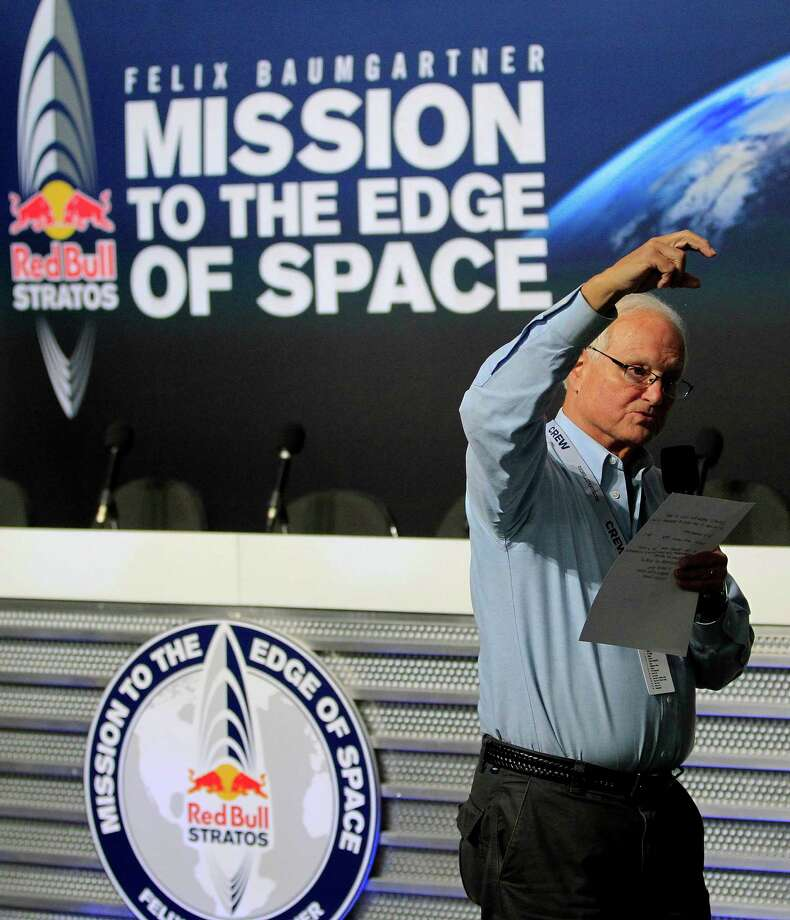 Mission Control broadcaster Robert Hager, talks about the latest weather conditions, ahead of an attempt by Felix Baumgartner to break the speed of sound with his own body by jumping from a space capsule lifted by a helium balloon, Sunday, Oct. 14, 2012, in Roswell, N.M.  Baumgartner plans to jump from an altitude of 120,000 feet, an altitude chosen to enable him to achieve Mach 1 in free fall, which would deliver scientific data to the aerospace community about human survival from high altitudes.(AP Photo/Ross D. Franklin) Photo: Ross Franklin
