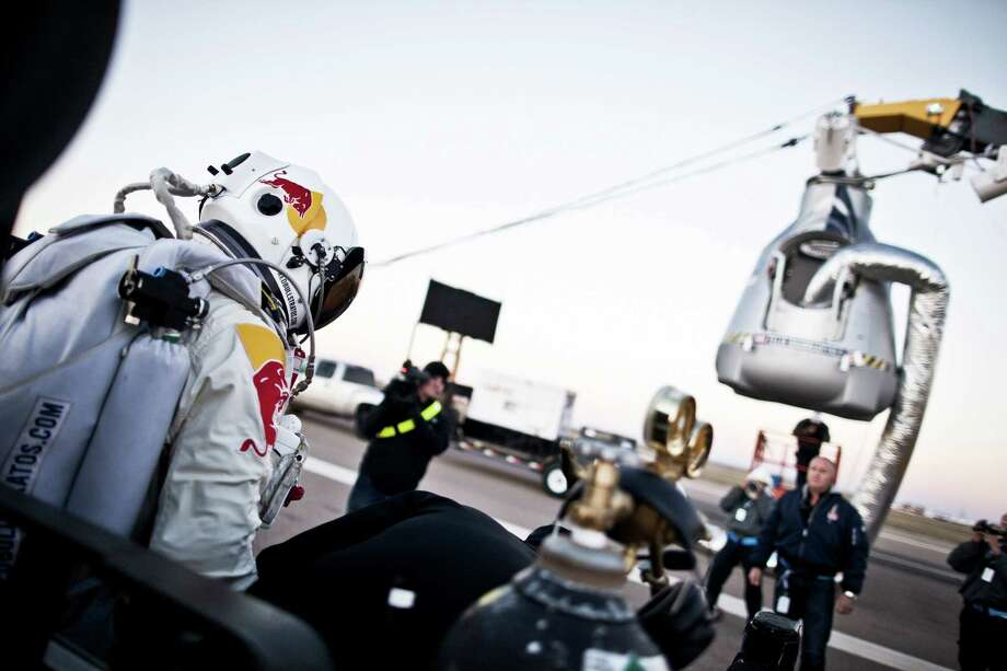 In this photo provided by Red Bull, Pilot Felix Baumgartner of Austria steps out from his trailer during the final manned flight for Red Bull Stratos in Roswell, N.M. on Saturday, Oct. 14, 2012.  Baumgartner plans to jump from an altitude of 120,000 feet, an altitude chosen to enable him to achieve Mach 1 in free fall, which would deliver scientific data to the aerospace community about human survival from high altitudes.(AP Photo/Red Bull, Balazs Gardi) Photo: Balazs Gardi
