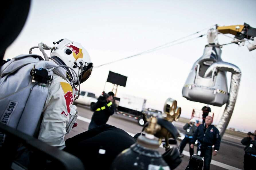 In this photo provided by Red Bull, Pilot Felix Baumgartner of Austria steps out from his trailer du