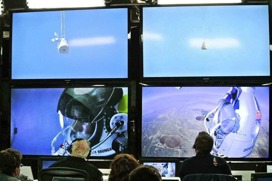 In this photo provided by Red Bull, pilot Felix Baumgartner of Austria is seen in a screen at mission control center in the capsule during the final manned flight for Red Bull Stratos in Roswell, N.M. on Sunday, Oct. 14, 2012.   Baumgartner plans to jump from an altitude of 120,000 feet, an altitude chosen to enable him to achieve Mach 1 in free fall, which would deliver scientific data to the aerospace community about human survival from high altitudes.(AP Photo/Red Bull, Stefan Aufschnaiter) Photo: Stefan Aufschnaiter