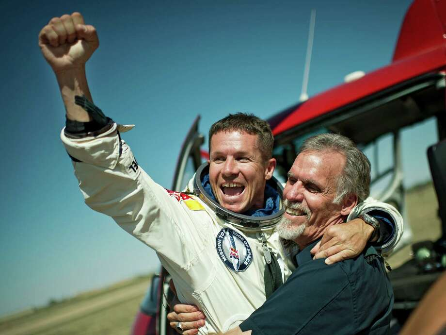 In this photo provided by Red Bull Stratos, pilot Felix Baumgartner of Austria and Technical Project Director Art Thompson, celebrate after successfully completing the final manned flight for Red Bull Stratos in Roswell, N.M., Sunday, October 14, 2012. Baumgartner came down safely in the eastern New Mexico desert minutes about nine minutes after jumping from his capsule 128,097 feet, or roughly 24 miles, above Earth. (AP Photo/Red Bull Stratos, Joerg Mitter) Photo: Joerg Mitter