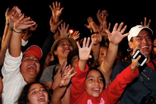 Spectators cheer as the space shuttle Endeavour arrives at Martin Luther King Boulevard after it's journey down Crenshaw Boulevard in Los Angeles, Calif., Saturday, Oct. 13, 2012. Endeavour's 12-mile road trip kicked off shortly before midnight Thursday as it moved from its Los Angeles International Airport hangar en route to the California Science Center. Photo: AP