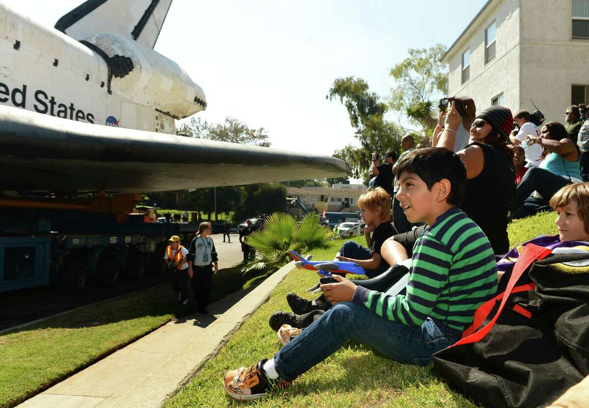Spectators watch the space shuttle Endeavour roll by Saturday, Oct. 13, 2012 in Inglewood, Calif. (AP Photo/Los Angeles Times, Wally Skalij) NO FORNS; NO SALES; MAGS OUT; ORANGE COUNTY REGISTER OUT; LOS ANGELES DAILY NEWS OUT; VENTURA COUNTY STAR OUT; INLAND VALLEY DAILY BULLETIN OUT; MANDATORY CREDIT, TV OUT