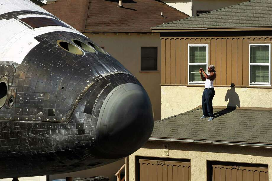 The Endeavour Space Shuttle makes its way toward the California Science Center on Saturday, October 13, 2012 in Inglewood, Calif. (AP Photo/Los Angeles Times, Rick Loomis)  NO FORNS; NO SALES; MAGS OUT; ORANGE COUNTY REGISTER OUT; LOS ANGELES DAILY NEWS OUT; VENTURA COUNTY STAR OUT; INLAND VALLEY DAILY BULLETIN OUT; MANDATORY CREDIT, TV OUT Photo: AP
