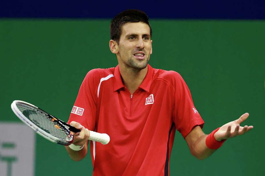 Novak Djokovic of Serbia reacts after missing a shot against Andy Murray of Britain during the men's singles final at the Shanghai Masters tennis tournament at Qizhong Forest Sports City Tennis Center in Shanghai, China, Sunday Oct. 14, 2012. (AP Photo/Eugene Hoshiko) Photo: Eugene Hoshiko